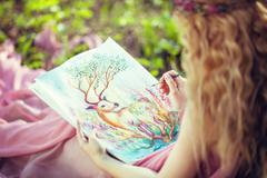 Girl paints watercolors in the Woods Stock Photos