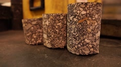 3 Cylindrical Sedimentary Rocks - Pan Up Stock Footage