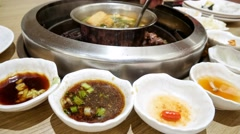 4k UHD time lapse video on eating Korean steamboat & barbecue Stock Footage