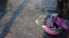Kids floating down the river together Stock Footage