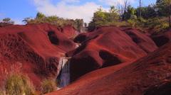 Red dirt waterfall in Waimea Canyon Kauai Hawaii Stock Footage