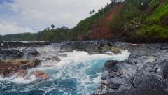 Waves craning in natural pool in Kauai Hawaii Stock Footage