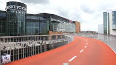Fancy bike path above the water in front of Copenhagen Mall   Stock Footage