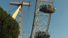 London Eye rotates in a blue sky, a tourist attraction to buy Stock Footage