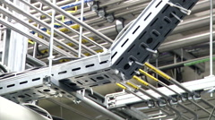 Panorama on the ceiling with wires in conduits (workshop) - stock footage