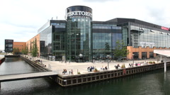 People outside Copenhagen Mall  at the waterfront - stock footage