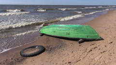 Retro wooden green boat on  sea resort beach and waves Stock Footage