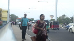 Local traffic in Matara, Sri Lanka, with people passing by. Stock Footage