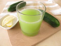 Cucumber juice with lemon Stock Photos