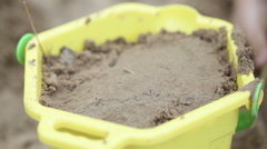 Pail with sand - stock footage