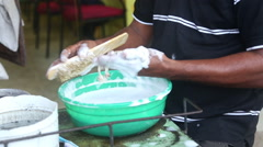 Close up view of a local man washing jewelry in Matara, Sri Lanka. Stock Footage