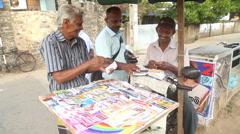MATARA, SRI LANKA - MARCH 2014: Men selling lottery tickets in Matara. Stock Footage