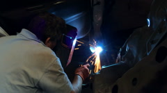 Worker with protective mask welding metal 4 Stock Footage