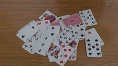 Playing cards on table Stock Footage