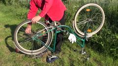 Repair retro bicycle on  garden grass Stock Footage