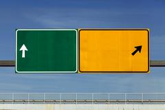 Road signs over overpass Stock Photos