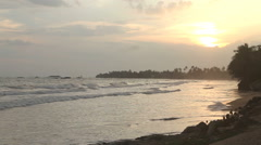 View of waves in bay in Matara at sunset. Stock Footage