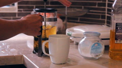 To make tea and to pour in a cup Stock Footage