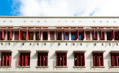 open colorful window shutters in chinatown district of singapore, asia - stock photo