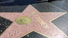 Walt Disney Star on walk of fame in Hollywood Stock Footage