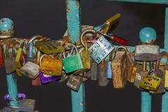 Many colorful padlocks locked together on a bridge Stock Photos