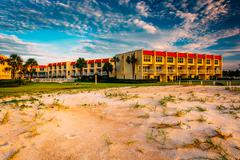 Sand dunes and beachfront hotel at st. augustine beach, florida. Stock Photos