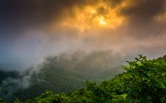 sunset through fog, seen from craggy pinnacle, near the blue ridge parkway, n - stock photo