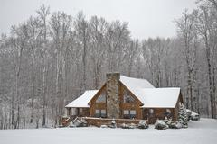 Stock Photo of log house in snowfall