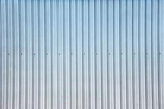 Wide shot of silver blue corrugated metal wall Stock Photos