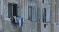 Washing hanging out of shuttered windows, colonial cuban architecture Stock Footage