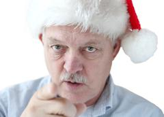 man in Santa hat is watching you - stock photo