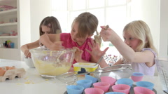 Three Little Girls Making Cake Together Stock Footage