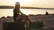 Beautiful woman relaxing on a beach Stock Footage