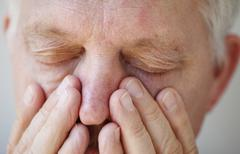 Sinus problems in senior man Stock Photos