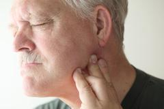 Older man with painful jaw Stock Photos