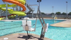 ADA Compliant Handicap Chair that Lowers into a Pool Stock Footage