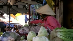 Vietnam Phú Mỹ district villages 073 to serve somebody on weekly market Stock Footage