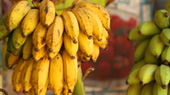 View of bananas hanging in local shop in Mirissa, Sri Lanka. Stock Footage