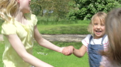 Three Girls Playing Ring-Around-The-Rosy Outdoors Stock Footage