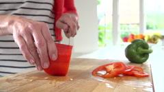Close Up Of Woman Chopping Peppers On Wooden Board Stock Footage