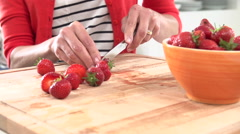 Slow Motion Sequence Of Woman Cutting And Eating  Strawberry Stock Footage