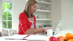 Woman Working From Home Using Laptop In Kitchen Stock Footage