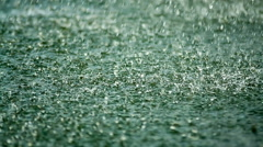 Shower, raindrop falling on the surface of the lake - stock footage