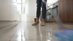 Time Lapse Sequence Of Woman Mopping Kitchen Floor Stock Footage