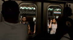 Commuters crowd of people enter MTA subway train in Queens in New York, USA Stock Footage