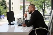 Young business man with a finger pointe Stock Photos