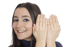 Woman appear behind her hands Stock Photos