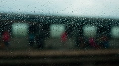 Rainy Window Passengers outdoor MTA subway platform in Queens, New York, USA Stock Footage