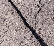 Cracked tarmac Stock Photos