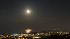 Time lapse of the moon and sky over the city of Bastia 4k Stock Footage